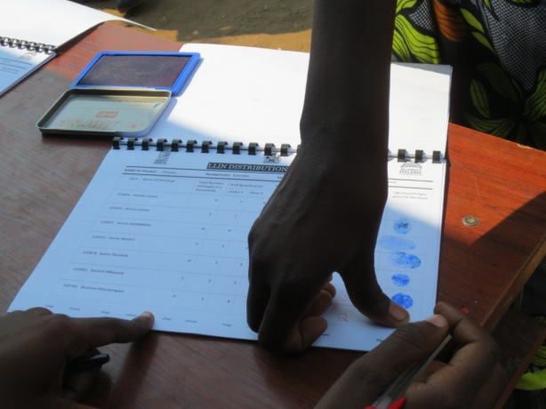 Villagers provide signatures using finger prints