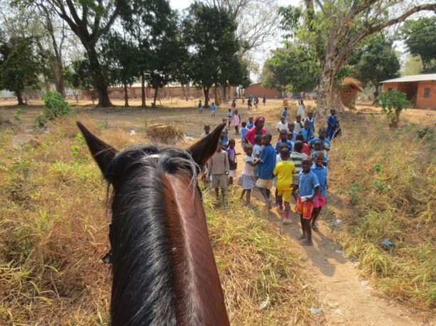 Riding past the local school caused quite a stir!